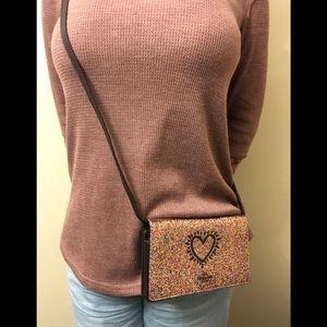 """COACH """"Keith Haring Glitter Heart Crossbody""""."""
